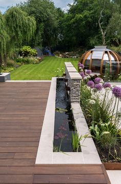 Contemporary family garden in Manchester featuring a hardwood deck, porcelain paving, stone clad feature walls and a water feature. Designed by Robert Hughes Garden Design, Cheshire Stone Water Features, Outdoor Water Features, Water Features In The Garden, Pool Water Features, Backyard Garden Design, Small Garden Design, Backyard Landscaping, Backyard Waterfalls, Contemporary Water Feature