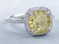 2.67 ctw Cushion Cut Diamond Engagement Ring. It has an attractive 2.18 ct Vivid Yellow color (Color Treated)/SI1 clarity, Clarity Enhanced Cushion Cut center diamond. Set in a beautifully custom designed 14k White Gold setting, this ring is listed for $9,890.  Follow this link to view this listing on our website:  http://www.bigdiamondsusa.com/2ctwcucutdie14.html  Contact Information: 1-877-795-1101   Toll Free 1-312-795-1100   International