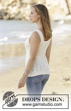 Set consists of: Knitted top with lace pattern in DROPS Alpaca and shoulder piece with lace pattern in DROPS Alpaca. Size: S - XXXL Free pattern by DROPS Design.