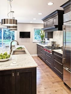 kitchen design - Home and Garden Design Idea's - Love this!  The recessed panel doors, the color, the counter, the backsplash.