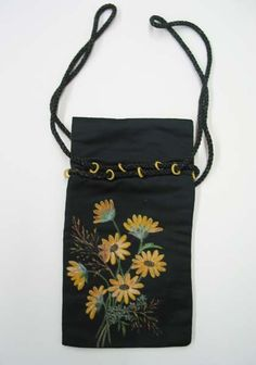 Date Made: 1890-1895  Description:  Purse; black with painted daisy bouquet, drawstring. Black fabric purse with painted daisy bouquet on front. Black cord drawstring inserted through yellow crocheted rings sewn near top edge. Lined in yellow fabric.