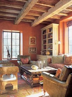 love the reclaimed raw wood ceiling and the terra cotta wall-this is allllll me