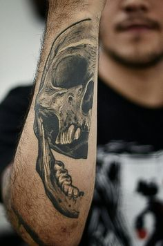"""skull tattoo on the other half of the arm get the other half of the skull but it has roots and trees and leaves and moss all covered in it. Then in some cool lettering underneath write something like """"from death comes life"""" or something like that"""