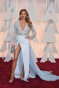 Model Chrissy Teigen in Zuhair Murad attends the 87th Annual Academy Awards at Hollywood & Highland Center on February 22, 2015 in Hollywood, California.