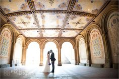 bride and groom under Bethesda Terrace in Central Park