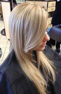 Icy platinum long blonde hair. Done by KatieB