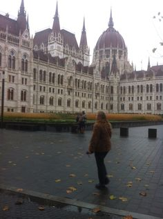 Millie being a tourist outside the Parliament building