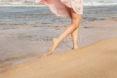 The young woman running on the beach stock photo (c) master1305 (#8293893) | Stockfresh