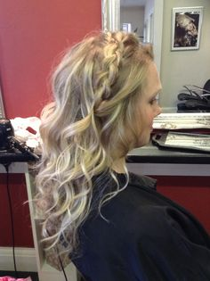 Loose waves with the wand and a relaxes teased braid across the top -Hair by Jac