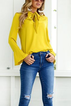 Add this top into your closet. An easygoing long sleeves top with self-tie design. We love pair it with jeans. It is best choice to go out with friend during weekend.