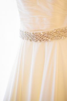Wedding Gown by Justin Alexander - See more on SMP - http://www.StyleMePretty.com/2014/01/08/grand-geneva-resort-wedding/ Carly McCray Photography