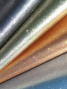 Glitter wallpaper! Would be an interesting accent in a hallway, bathroom, or closet space