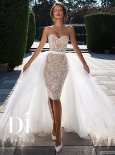 Diamtano short lace wedding dress with tulle train. Enjoy RUSHWORLD boards, WEDDING GOWN HOUND, UNPREDICTABLE WOMEN HAUTE COUTURE and LULU'S FUNHOUSE. Follow RUSHWORLD! We're on the hunt for everything you'll love!