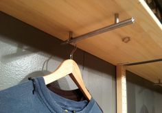 Drawer pulls under shelving creates a space to hang clothing