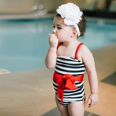 Sailor stripes only get sweeter with a charming red sash! La Petite Showstopper Swimsuit from Albion.