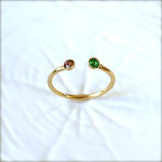 Gold Birthstone Ring by illuminancejewelry on Etsy, $36.00  I want it with sapphire and aquamarine :)