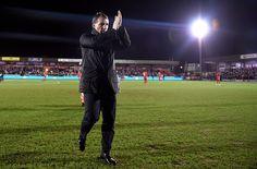 Brendan Rodgers the manager of Liverpool acknowledges the fans prior to kickoff during the FA Cup Third Round match between AFC Wimbledon and Liverpool at The Cherry Red Records Stadium on January 5, 2015 in Kingston upon Thames, England.