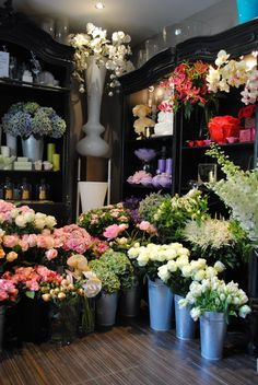By Appointment Only Design, London- flowers look good against black. Love the floors.
