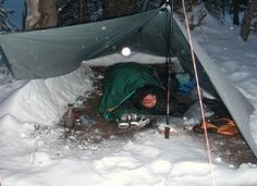 Learn how to make a rope/tarp shelter & survive a 13 degree MN night.