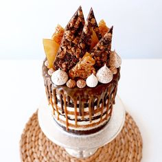 This one is a mouthful...chocolate and caramel snickers mud cakes layered between peanut butter and vanilla bean buttercreams, drizzled with dark chocolate and salted caramel, topped off with meringues, peanut brittle, toffee and chocolate snickers shards. Phew!  Inspired by @katherine_sabbath and all her genius cake skills. Holy peanuts!