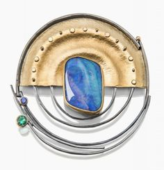 SYDNEY LYNCH - Solar pin/pendant; Boulder opal, emerald, sapphire, 18k & 22k gold, oxidized silver.  2 1/2 inches in diameter.  Can be worn as pendant.  Chain or cable is extra.  $4070.