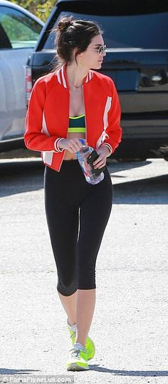 Designer v casual: While kendall looked every inch the model in her cropped track jacket a...