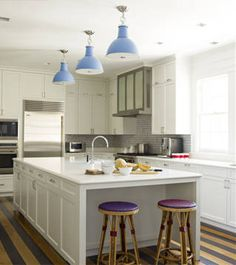 """Who: Katie Ridder   What: Paper White, OC-55, Benjamin Moore (shown in photo at left)  Why: """"I use it in kitchens and bathrooms because it melds the grays of Carrara marble and the stark white of sinks and toilets."""""""