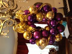 Ornament wreath made with wire hanger and yard sale ornaments......total cost about $1.50.  Took about an hour to make though because I had to glue all the tops on the ornaments down. Everytime I'd get close to filling it balls would just POP off! Grrrr, but it looks fabulous now.