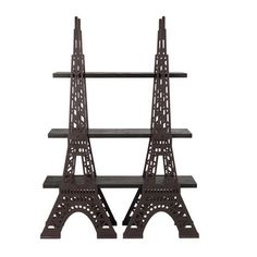 Add worldly charm to your favorite reading nook with this sturdy bookshelf, showcasing metal cutwork silhouettes of the Eiffel Tower.