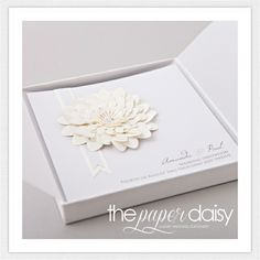 Luxury Wedding Invitations and Stationery from The Paper Daisy This design is called Anya, from the Luxe Collection, a range of cream embellisments on pale grey card, crafted by hand using luxury paper and decorated with Swarovksi Crystals. Prices start at £5.25 each