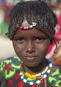 iseo58:  Afar Tribe Girl, Assayta, Ethiopia Funny a little Western influence in the hair