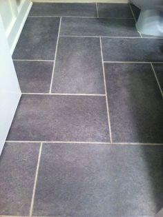 Groutable vinyl tile slate floor. Update a standard sized bathroom for $115.