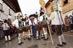 Carnival (Fasching) parade in Thaur, the men presenting the for seasons of the…