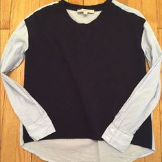 """Loft top Only worn once!! This is a sweatshirt/top with a twist. Front of shirt is navy, very finely ribbed. The rest of the short is blue and white pinstripe. This has a boxy fit to it. Longer in the back. I'm 5'2"""" and it covers my backside. Would looks really cute with a pair of jean shorts. Great for one of those cool Spring/Summer evenings. Cotton and polyester blend.  LOFT Tops"""