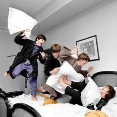 The Beatles -- from left, Paul McCartney, John Lennon, Ringo Starr and George Harrison -- letting off steam with a pillow fight. Harry Benson, Ringo Starr, George Harrison, Paul Mccartney, John Lennon, Pop Rock, Rock And Roll, The Beatles, Pillows