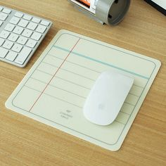 a mouse pad shaped like a piece of lined paper - a perfect accessory for your desk