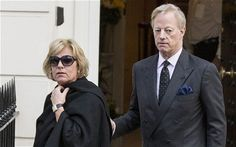 Carol Thatcher arrives at the home of her late mother in central London greeted by her brother Mark.