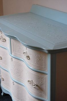 Pretty dresser with embossed paper #shabbychicdressersdiy