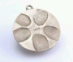 Finger print ornament DIY .. baking clay and silver spray paint