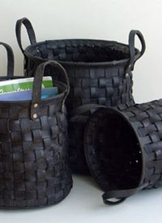 Recycled Tire Basket - Strips of recycled rubber tires woven together to create durable baskets.