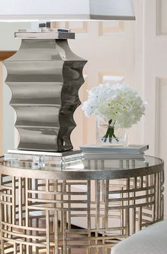 gray ceramic lamp with wrought iron table in antiqued silver leaf; occasinal tables; living room ideas