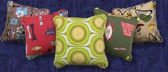 Retro pillows are awesome.  These are new but look just like the old prints.