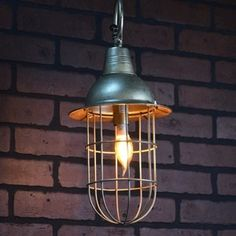 Vintage Style Caged Pendant Light will add an industrial vibe to your lighting. Visit Antique Farmhouse for more industrial light fixtures.