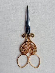 # 55 Just shy of 4 inches, intricate, engraved embroidery scissors created by Jean Marie Roulot, Nogent, France. Case included.