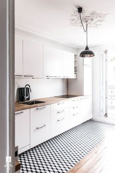 an airy Scandinavian kitchen with white cabinets, butcherblock countertops, a ge. an airy Scandinavian kitchen with white cabinets, butcherblock countertops, a geometric floor and p White Kitchen Cabinets, Kitchen Tiles, Kitchen Flooring, New Kitchen, Kitchen White, Kitchen Modern, Kitchen Wood, Kitchen Corner, Oak Cabinets