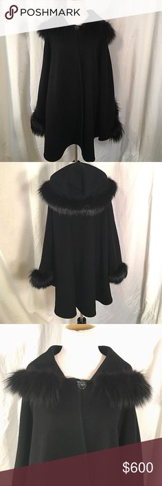 St. John Black Cashmere Cape with Fox Fur Trim. Stunningly beautiful Cashmere St.John black Cape. The cape is 100% Cashmere with Fox Fur trim on the hood and at the arm holes. It has a beautiful jeweled button closure at the neckline. The cape doesn't just drape over your shoulders, it actually has separate armholes to keep you cozier. Perfect for a dressy evening out on the town or to run around on the weekends in jeans and boots.  Very classy. The cape looks brand new. No signs of wear…