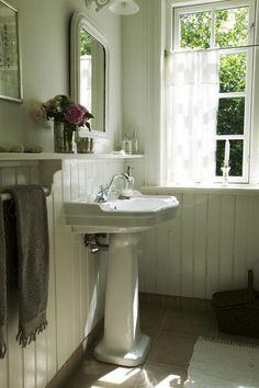 vintage + pedestal sink + wainscoting