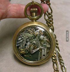 Artist manipulates tiny Watch parts into sculpture. -Amazing'