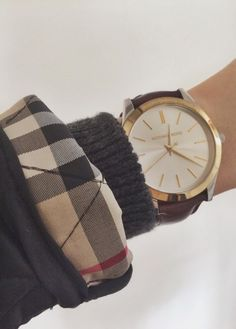 Cuffed plaid sleeve with pretty gold watch. Perfect for winter!