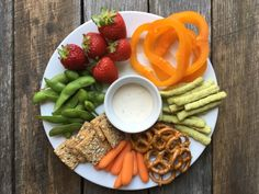 Here's an easy way to encourage healthy snacking: snack platter for kids that include a variety of nutritious foods served in a fun way.